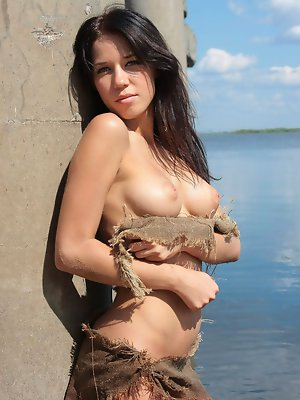 Sabinna shows off her ink puffy nipples and slender curves while allowing her perky breasts to soak up the sun.