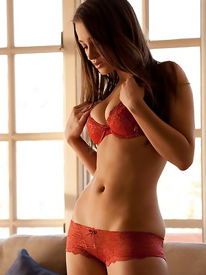 takes off her red top