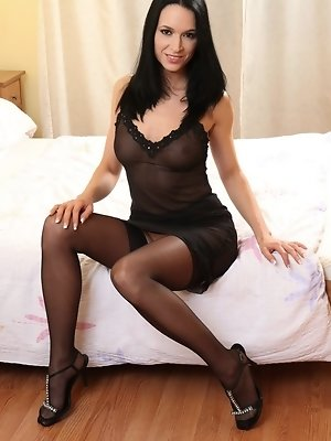 """Skinny brunette in black stockings and lingerie"""