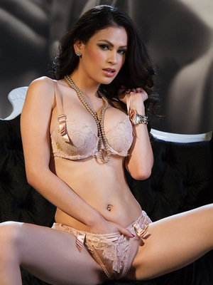 Vanessa Veracruz so sexy showing off her goods on the fancy black couch.