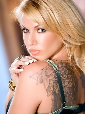 Angie Savage may have angel wings tattooed on her back but this big breasted blonde temptress is full of sinful carnal desires and intentions!