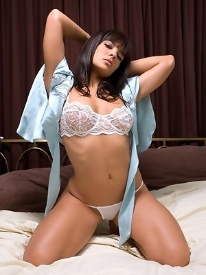 Krista Ayne rolling around in her bed without her panties.